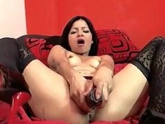 Indian chick plays with huge dildo